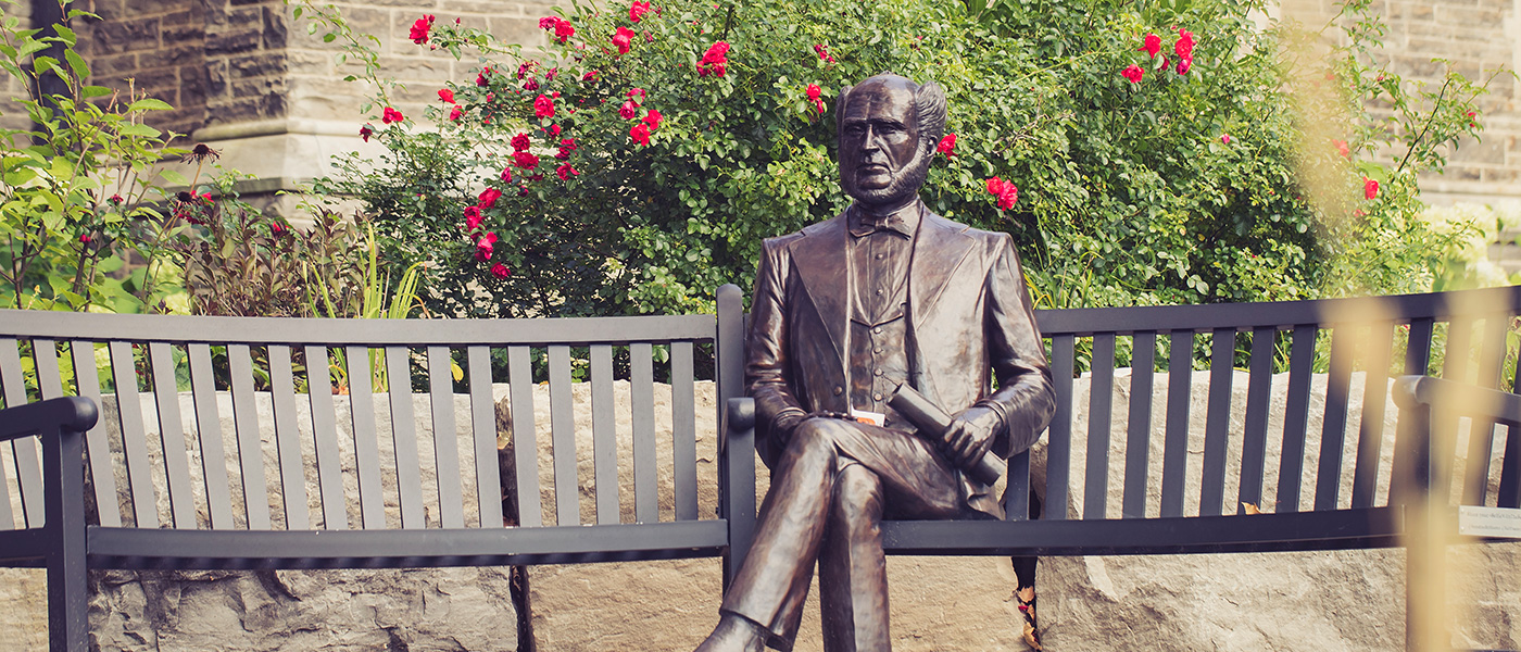 Statue of William McMaster Sitting on bench