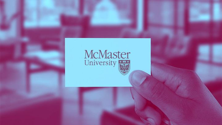 Hand holding McMaster business card